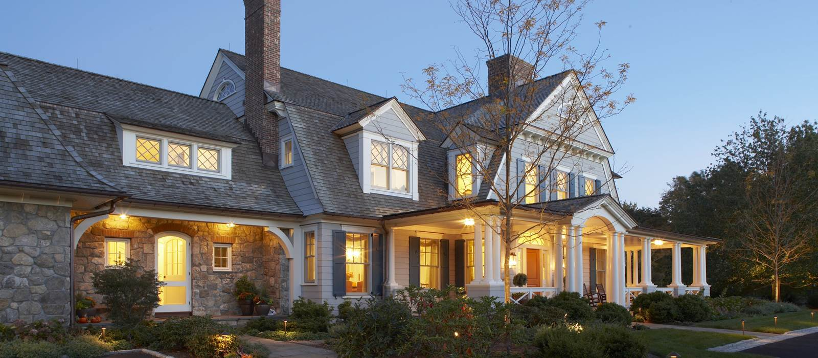Dutch Colonial exterior at dusk in Rye, NY